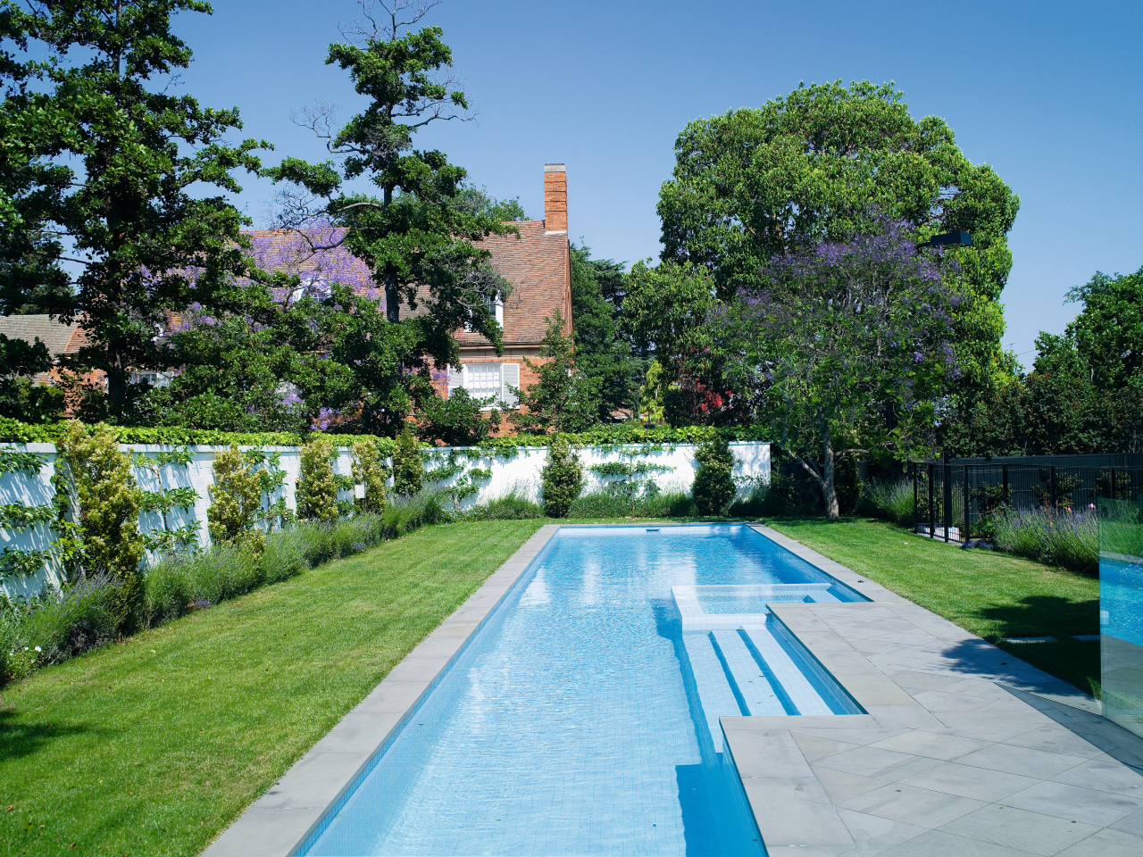 View of the long Pool that features perimeter daytime, estate, garden, leisure, mansion, plant, property, real estate, reflecting pool, reflection, sky, swimming pool, tree, water, waterway, green, teal