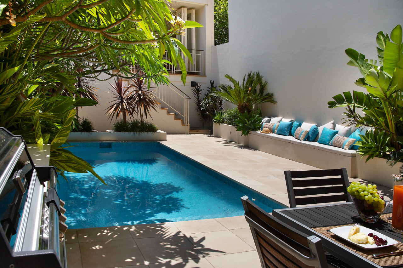 View of this Secluded pool surround by lush backyard, leisure, majorelle blue, plant, property, real estate, resort, swimming pool, tree, water, gray, brown