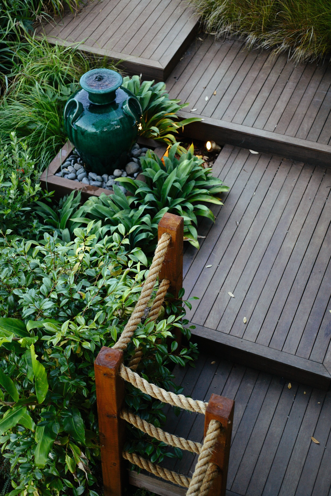 Go for a balance of hardscaping and softscaping. garden, leaf, outdoor structure, plant, tree, yard, gray, green
