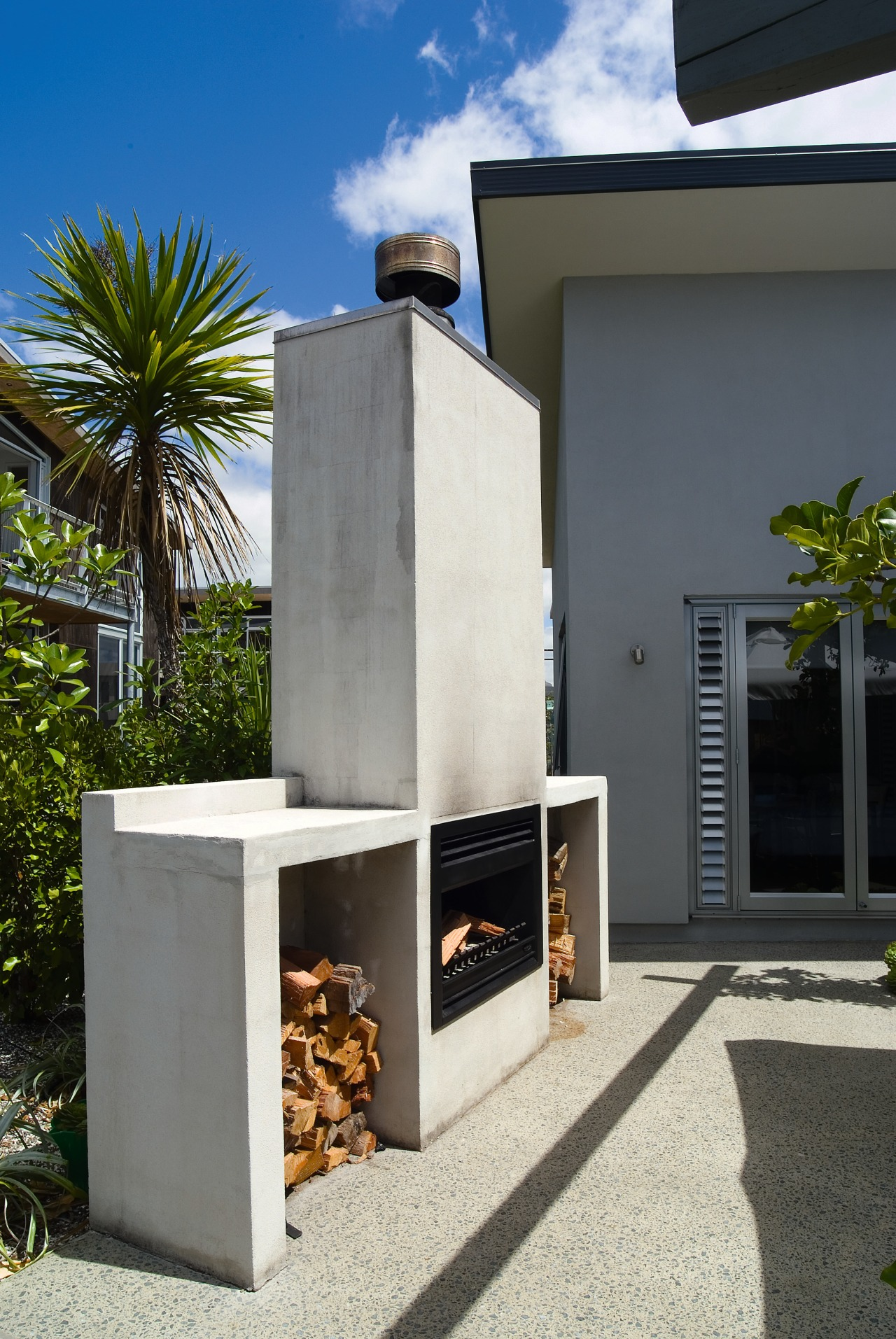 View of the precast fireplace  and exposed house, gray