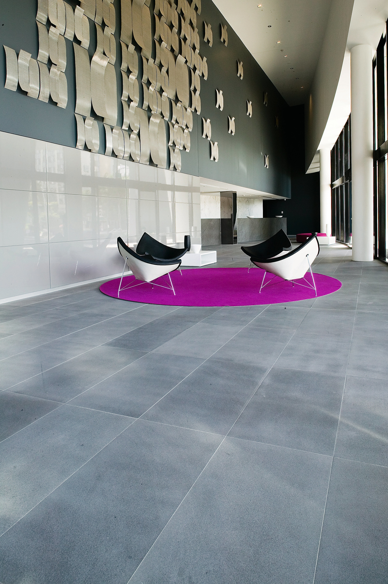 A view of the honed black granite tiles architecture, floor, flooring, interior design, laminate flooring, product design, table, tile, wall, gray