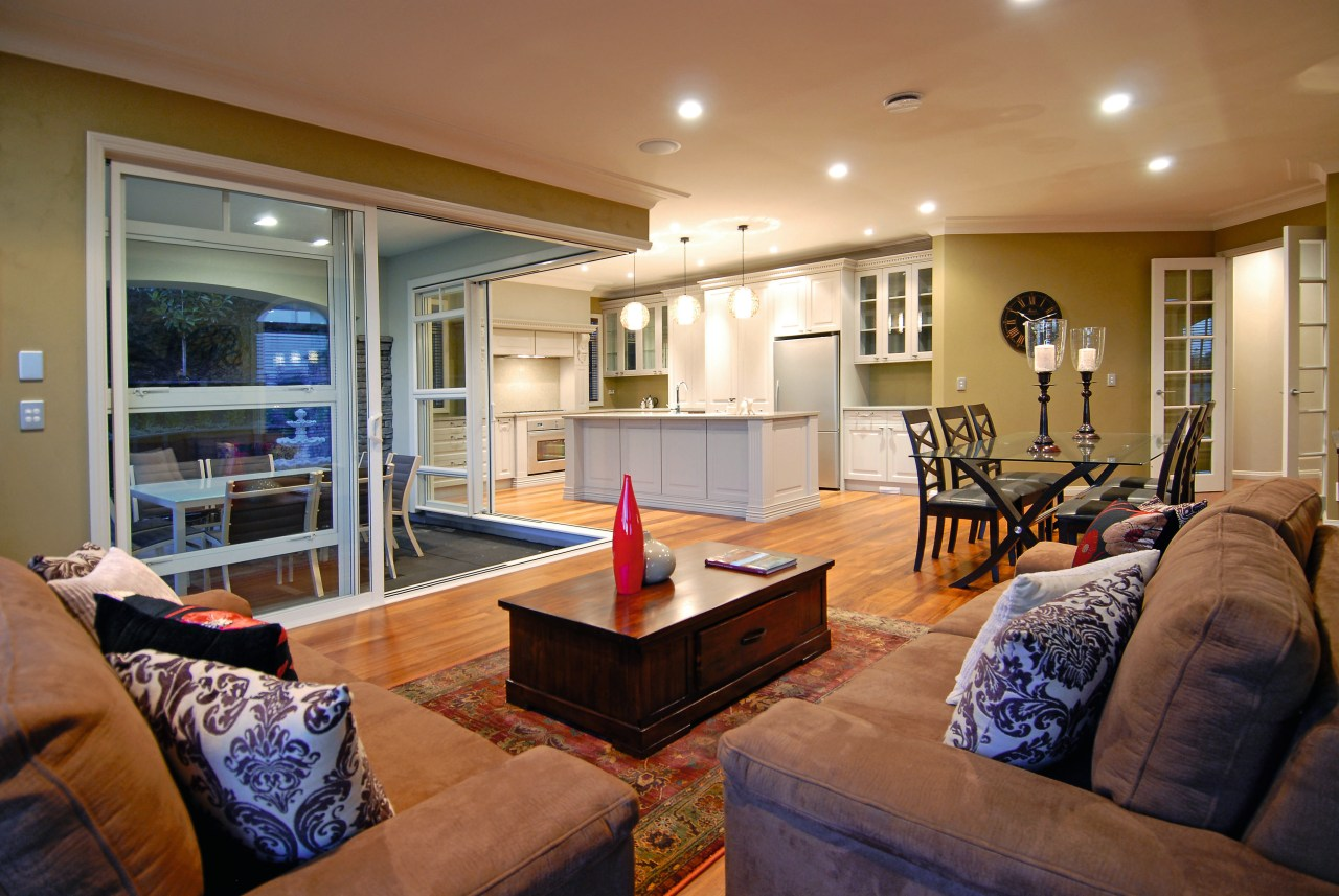 A view of a home designed and built ceiling, home, interior design, living room, property, real estate, room, brown