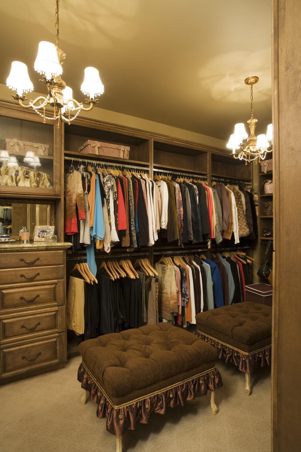 A view of the walk in wardrom accessed boutique, closet, furniture, interior design, room, brown, orange