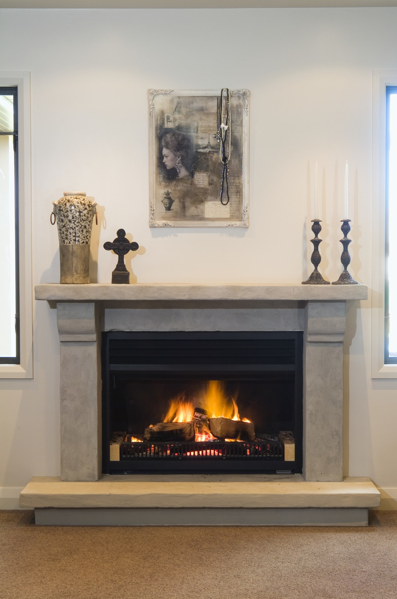 In keeping with the modern rustic aesthetic of fireplace, hearth, heat, home, interior design, living room, wood burning stove, gray