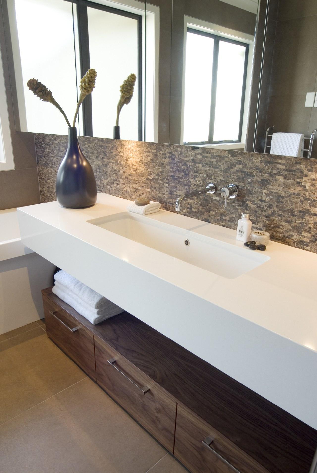A view of some bathroomware from Robertson Agencies. bathroom, countertop, floor, flooring, hardwood, interior design, plumbing fixture, room, sink, tile, wood, white, gray