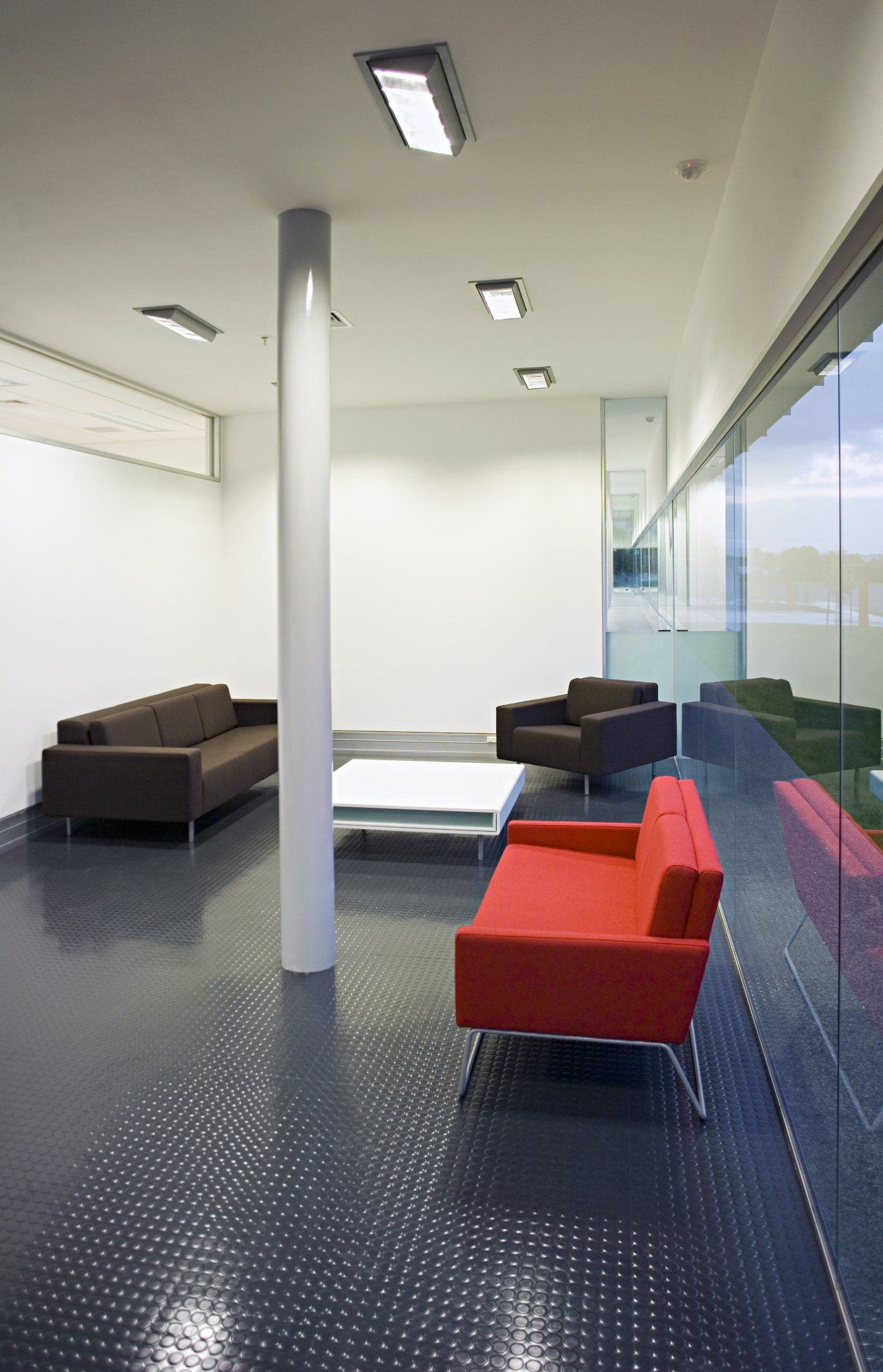 The high horizontal window in reception pulls light architecture, ceiling, daylighting, floor, flooring, furniture, interior design, office, product design, table, gray, white