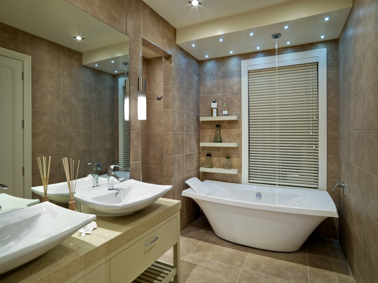 A view of some bathroomware from Kholer. bathroom, estate, home, interior design, room, brown, gray