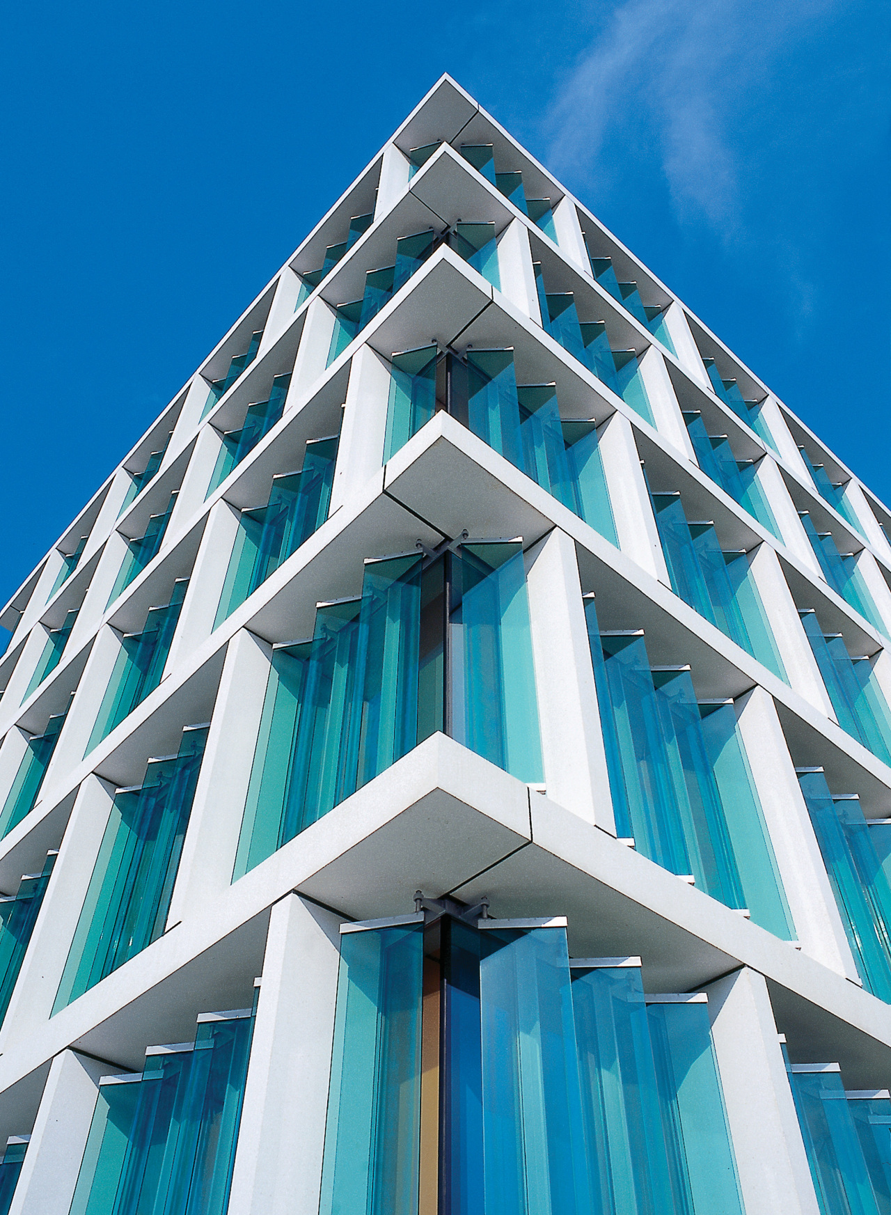 Colt Tolfab offers a range of sunshades and angle, architecture, blue, brutalist architecture, building, commercial building, condominium, corporate headquarters, daylighting, daytime, elevation, facade, headquarters, landmark, line, sky, skyscraper, structure, symmetry, tower block, teal, blue