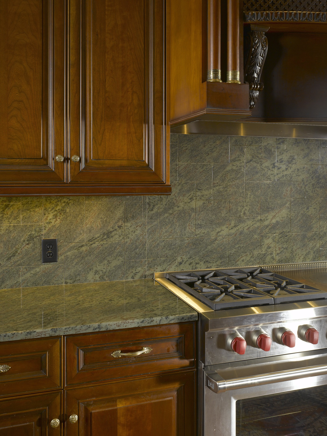 View of a stone countertop by A Touch cabinetry, countertop, floor, flooring, hardwood, interior design, kitchen, room, tile, under cabinet lighting, wall, wood, wood flooring, wood stain, brown