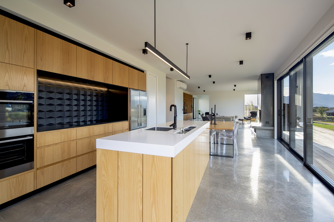 Wood cabinetry finishes and a polished concrete floor gray