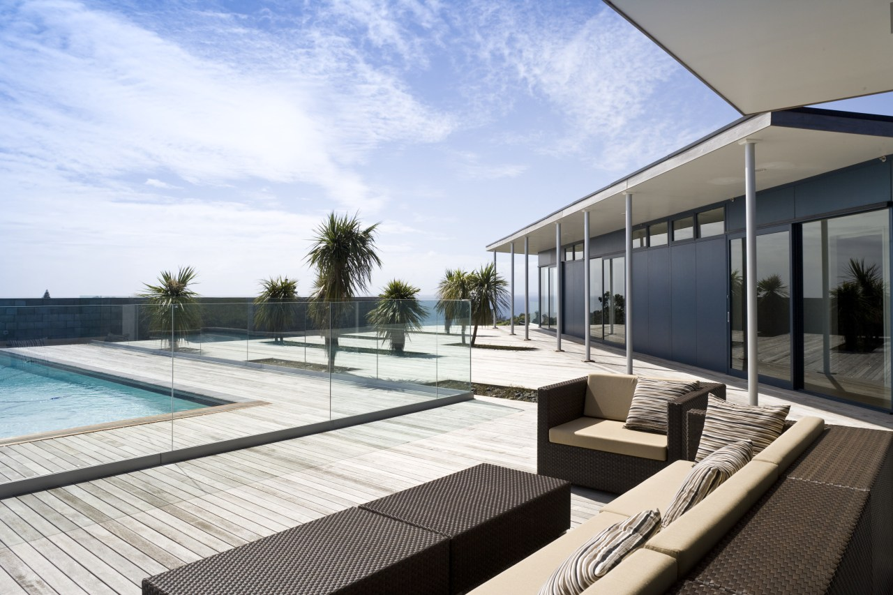 Image of the exterior of this beautifully designed apartment, architecture, condominium, estate, house, leisure, leisure centre, penthouse apartment, property, real estate, resort, swimming pool, white