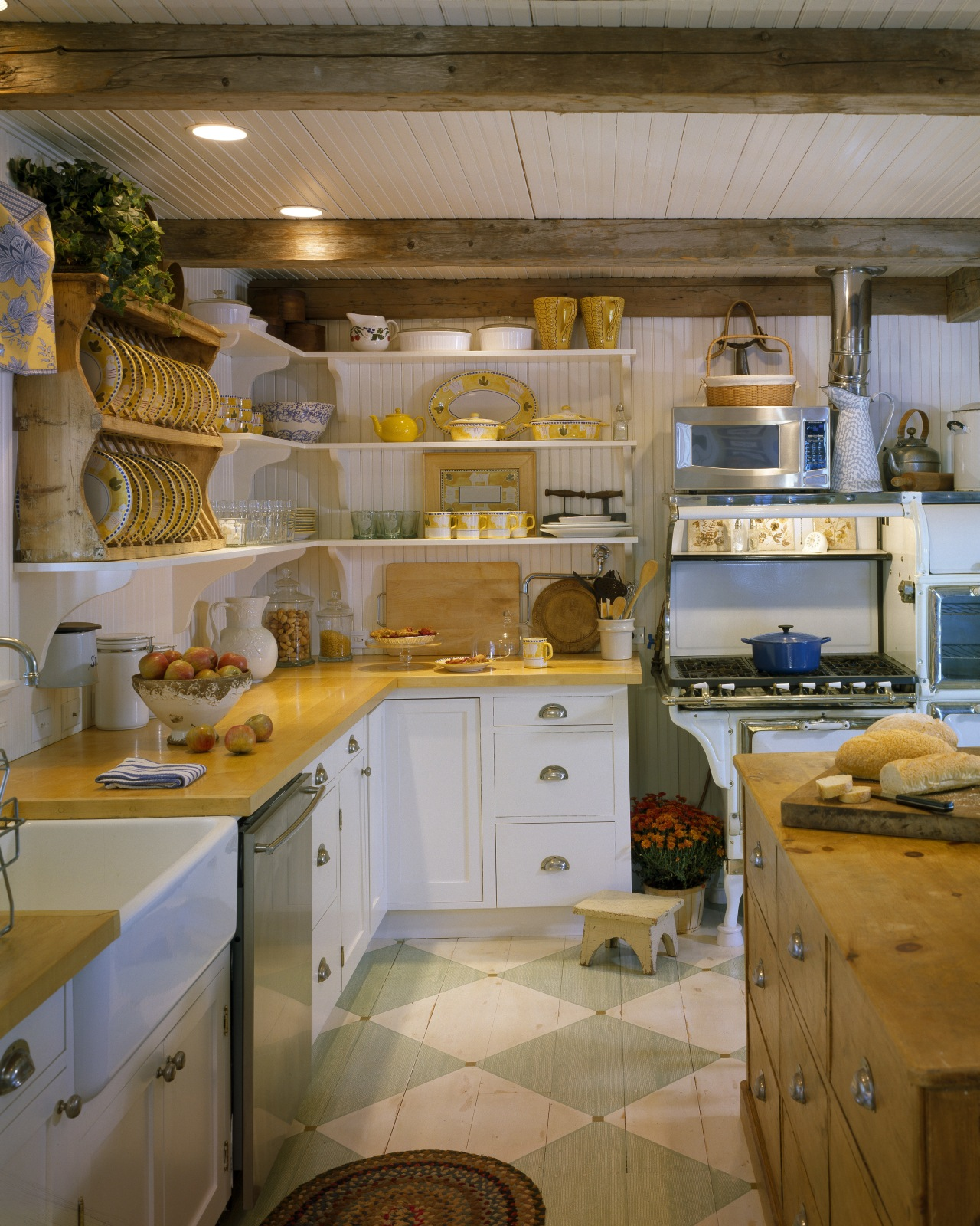 View of a remodelled country-styled kitchen which features cabinetry, countertop, cuisine classique, interior design, kitchen, room, brown, gray