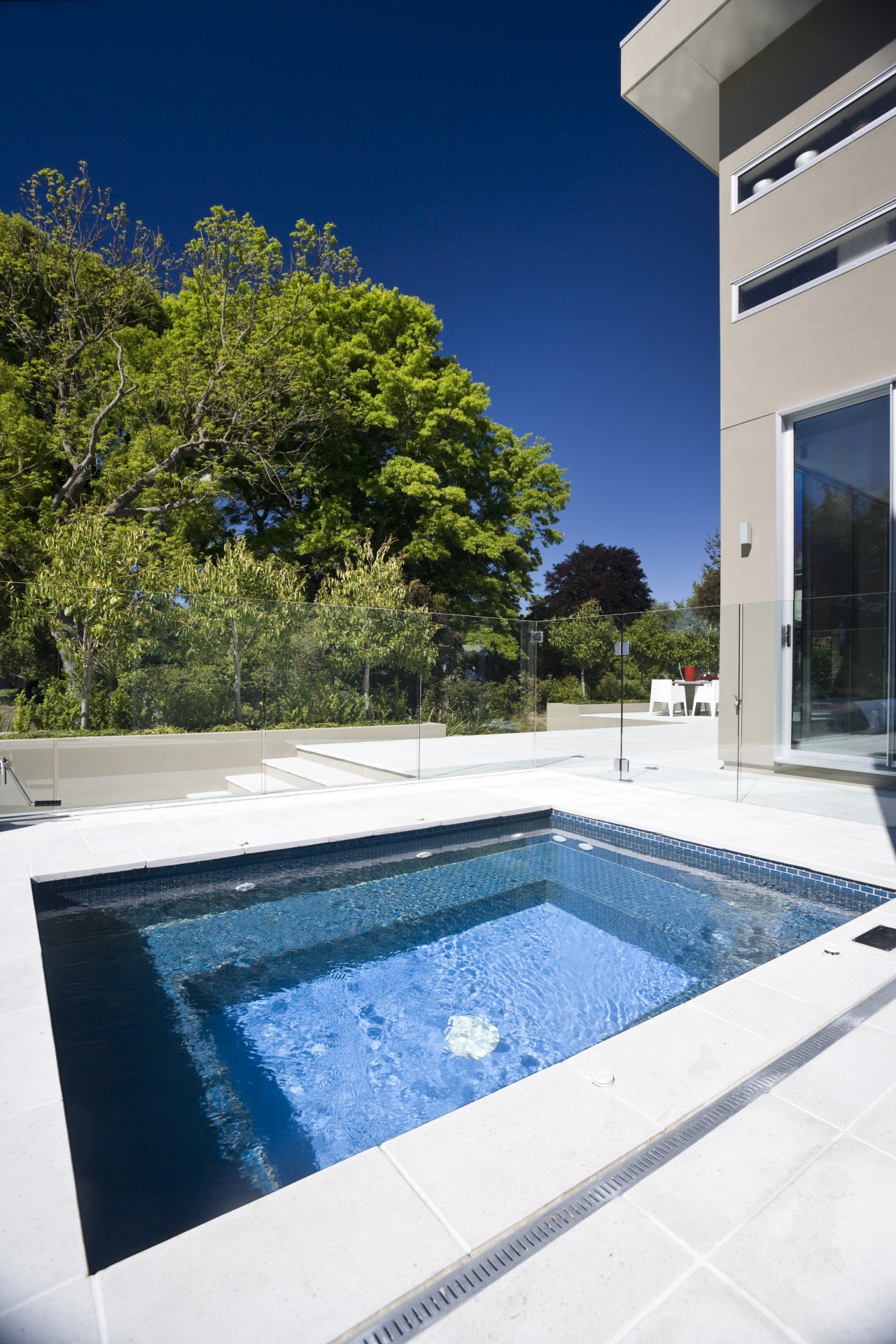 Exterior view of house and spa pool area architecture, estate, home, house, leisure, property, real estate, reflection, sky, swimming pool, vacation, villa, water, white, blue