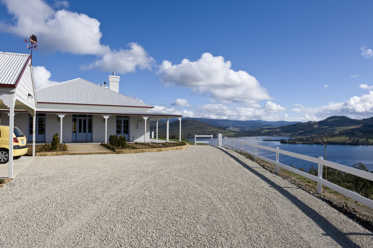 Exterior view of Victorian-syle house featuring steel roofing, cloud, coast, cottage, estate, home, house, mountain, property, real estate, sky, villa, water, gray