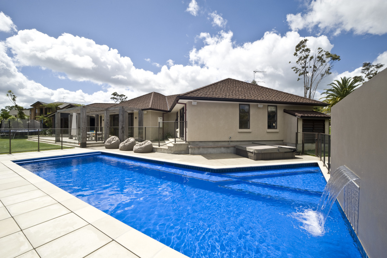Exterior view of house which features a pool estate, home, house, leisure, property, real estate, residential area, swimming pool, villa, white