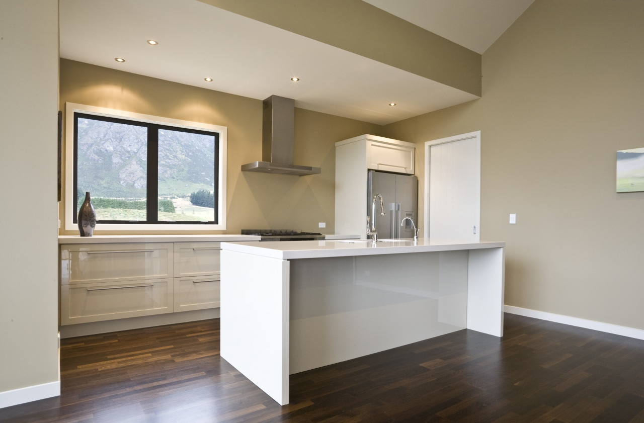 view of a show home kitchen where the cabinetry, ceiling, countertop, floor, flooring, hardwood, home, interior design, kitchen, laminate flooring, property, real estate, room, wood flooring, gray, brown