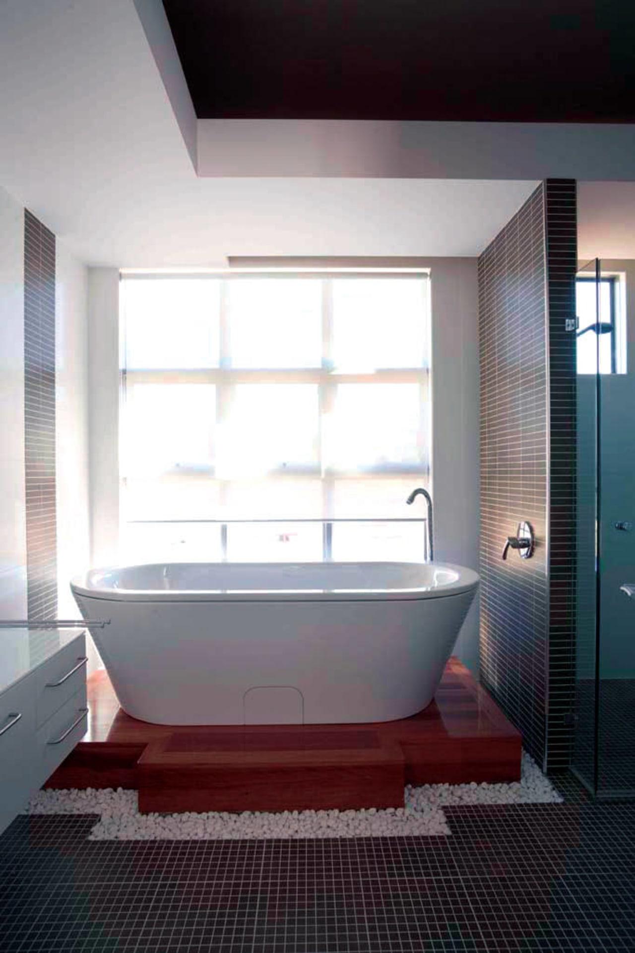 View of the bathroom of a high-end custom architecture, bathroom, bathtub, ceiling, daylighting, floor, interior design, plumbing fixture, room, window, white, gray, black