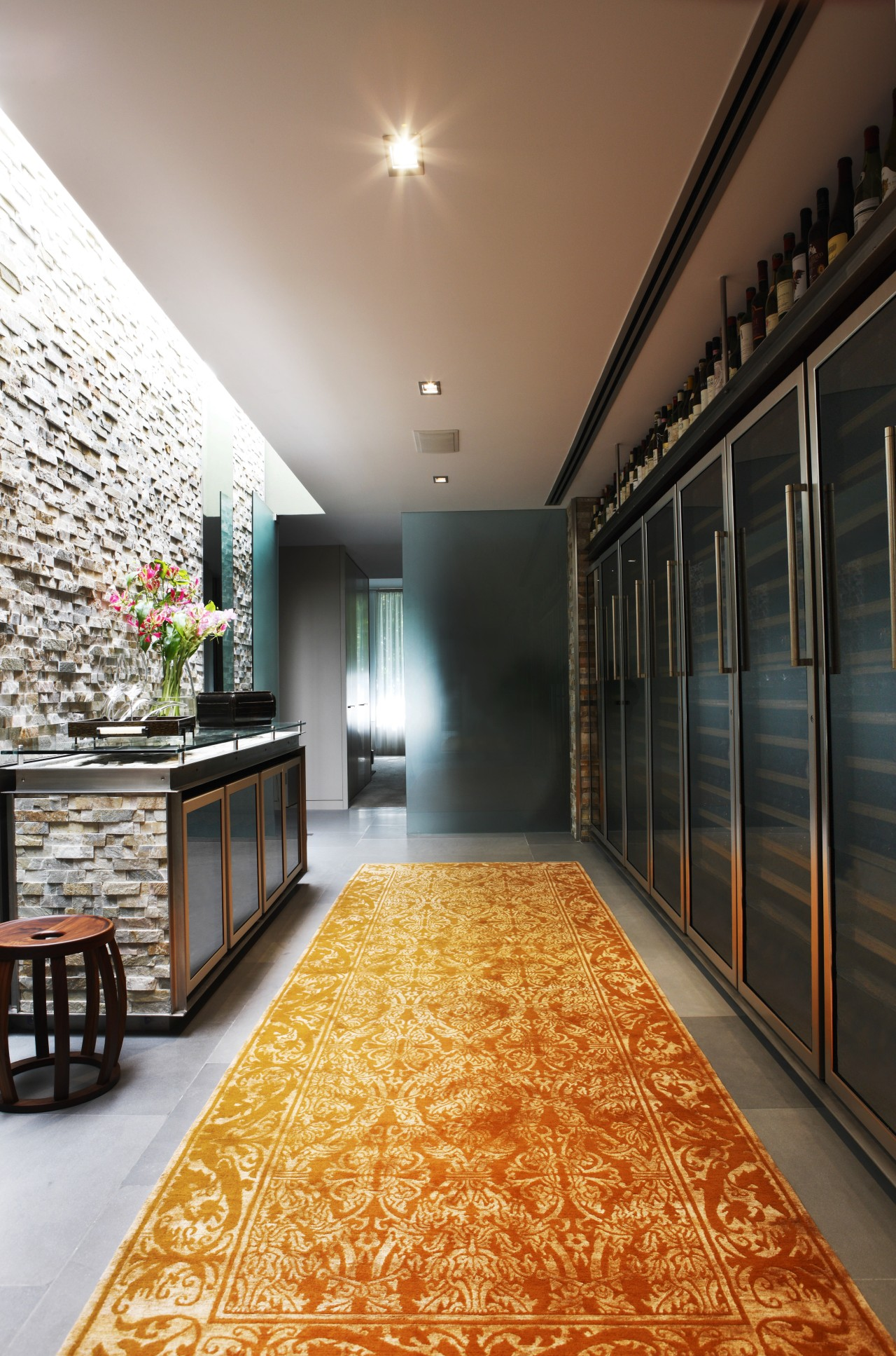 View of an apartment which features wine storage ceiling, floor, flooring, home, interior design, lobby, real estate, wall, wood, black, brown