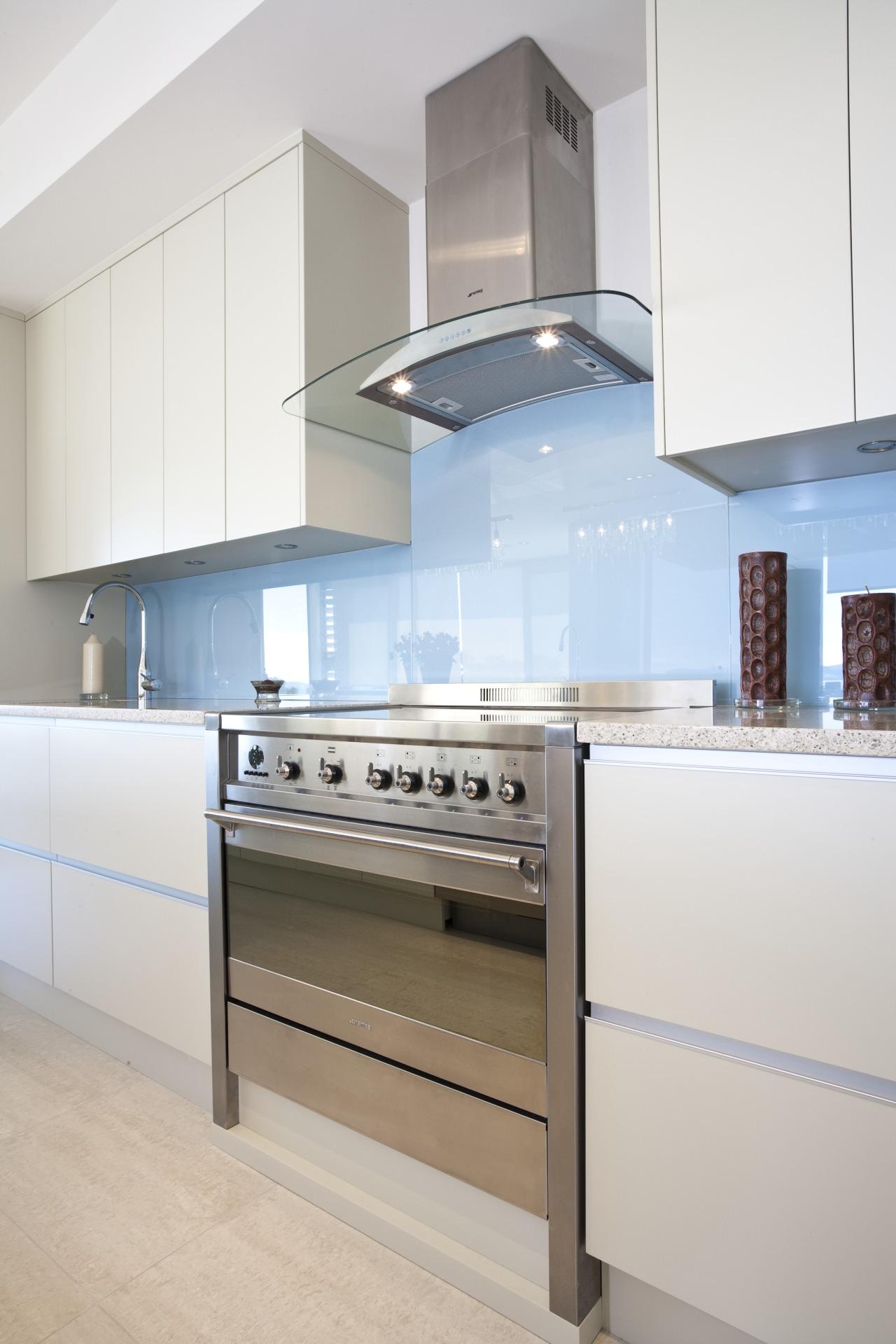 View of a kitchen which features Smeg appliances cabinetry, countertop, cuisine classique, home appliance, interior design, kitchen, kitchen stove, white