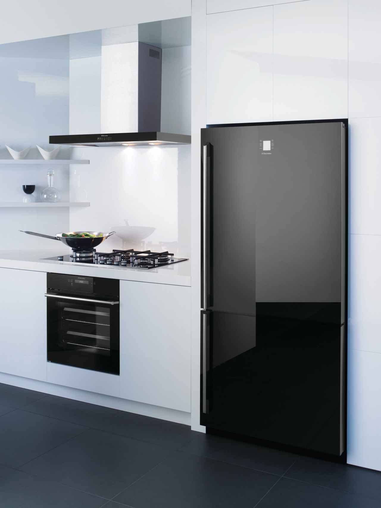 View of a kitchen which features a refrigerator, home appliance, interior design, kitchen, kitchen appliance, kitchen stove, major appliance, product, product design, refrigerator, white, black