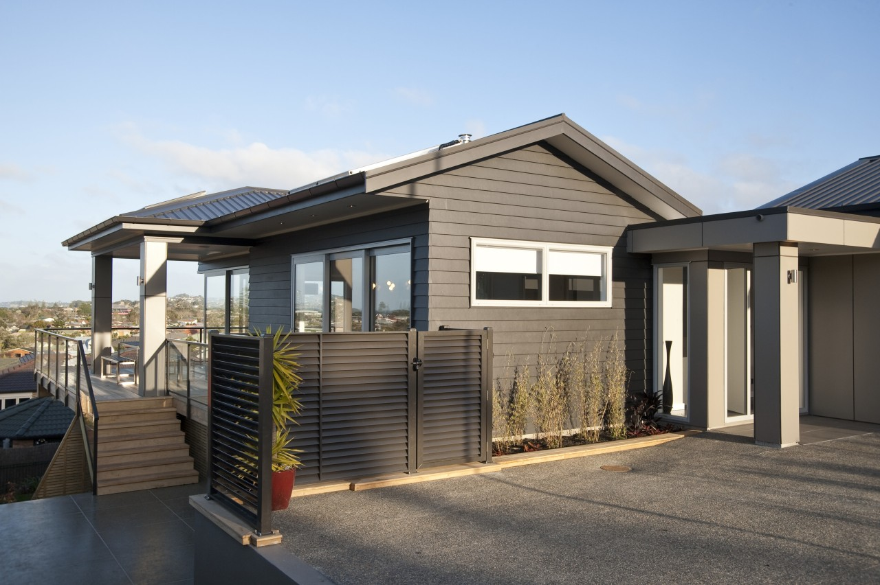 Exterior view of this DRH show home which building, elevation, facade, home, house, property, real estate, residential area, siding, black