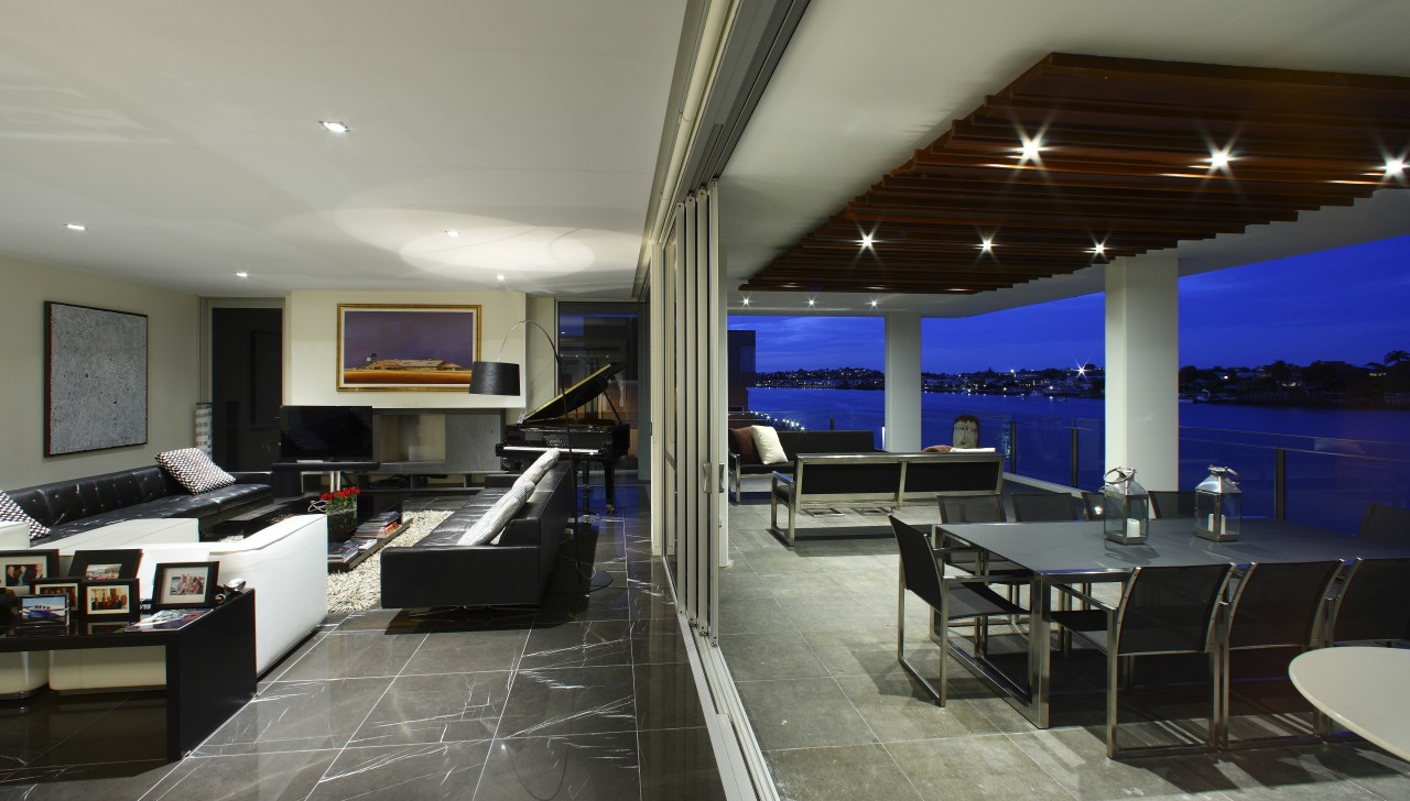 View of the apartment balcony which juts out apartment, ceiling, interior design, living room, real estate, gray, black