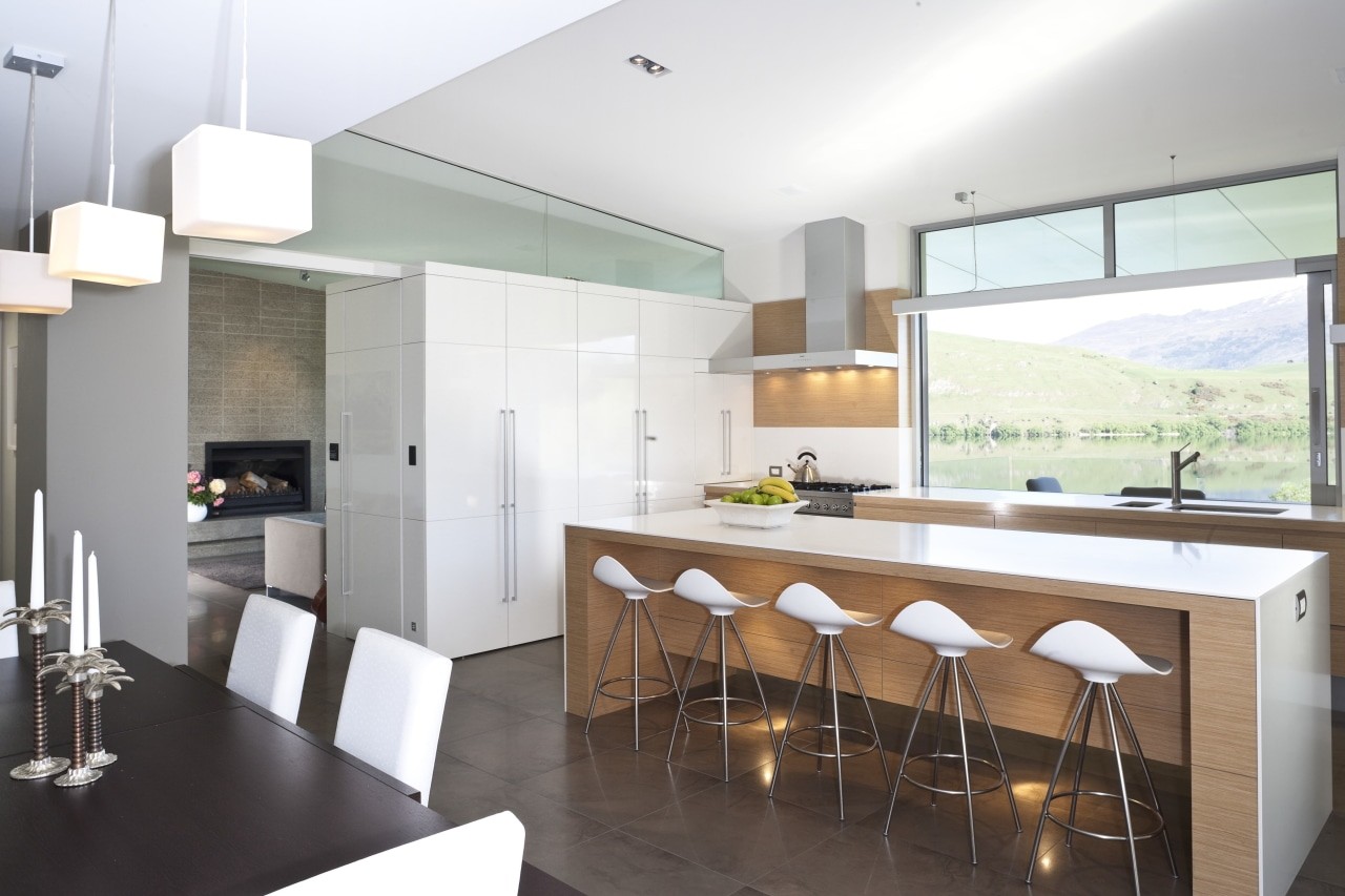 View of kitchen and living area featuring light architecture, countertop, interior design, kitchen, real estate, white