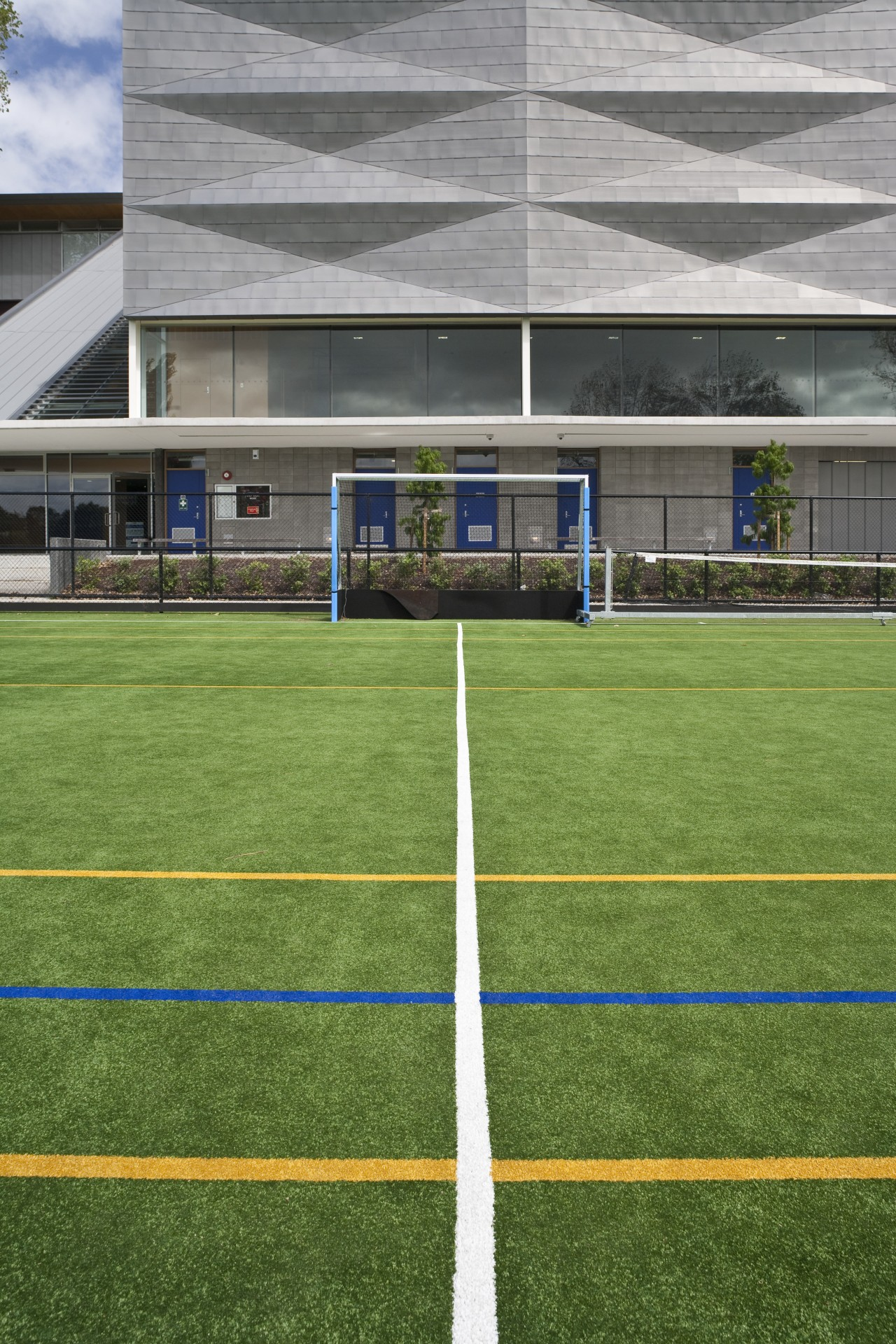 Exterior view of the St Kents' sporting facility artificial turf, ball game, grass, lawn, line, plant, soccer specific stadium, sport venue, sports, stadium, structure, team sport, green, gray