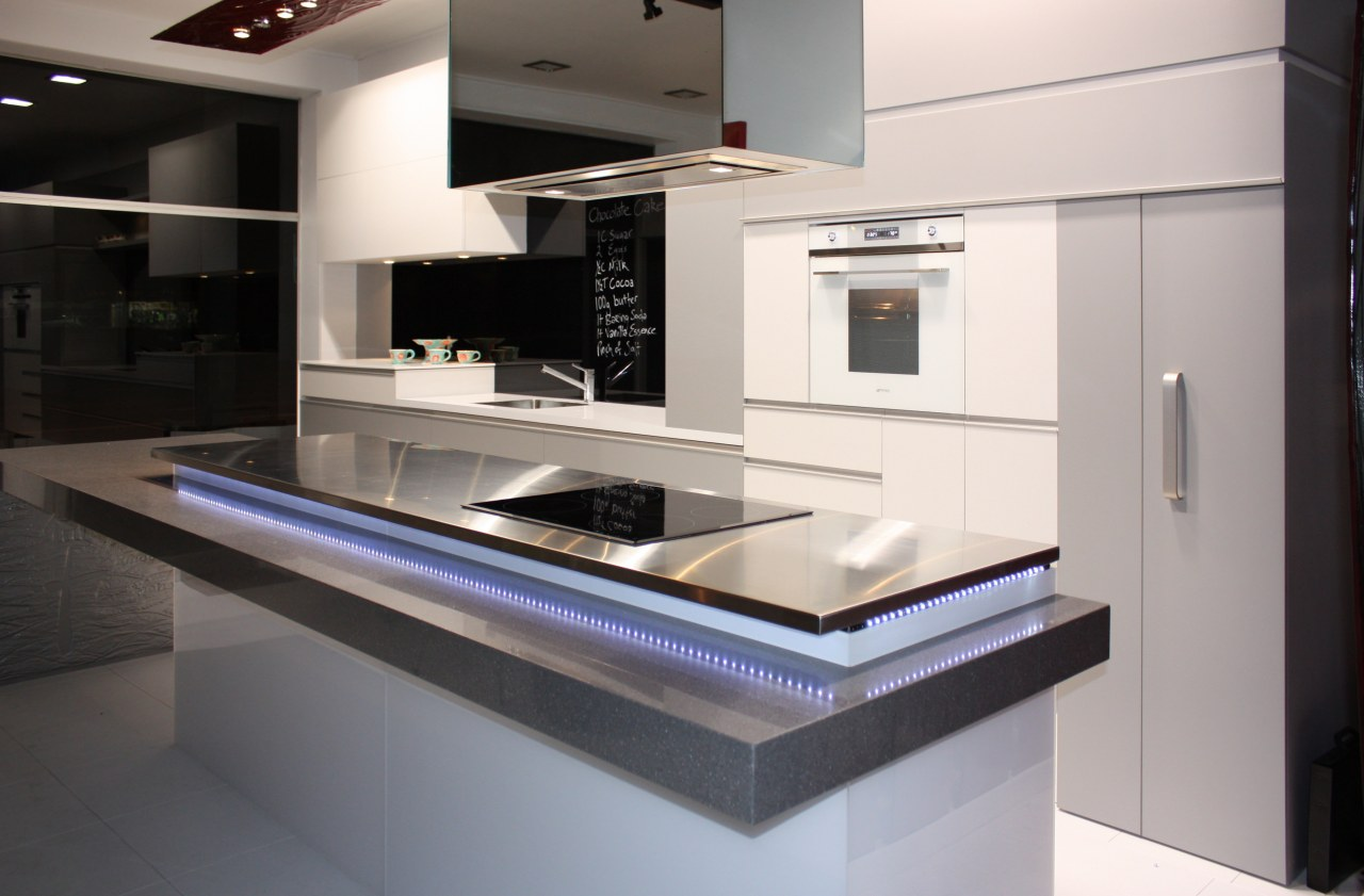 Interior view of this contemporary kitchen featuring LED countertop, home appliance, interior design, kitchen, product design, gray, black