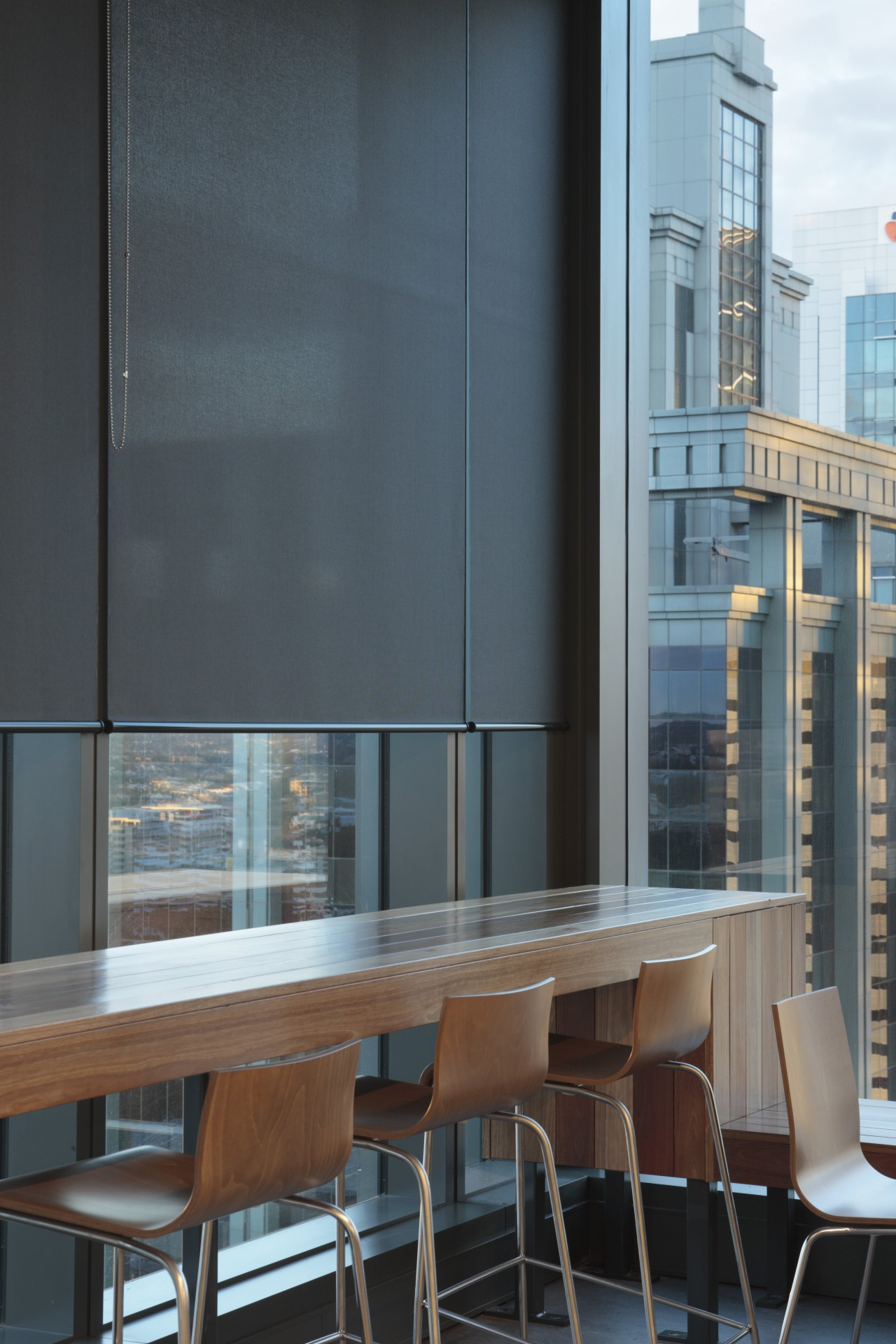 Interior view of 34-Story building with blinds from apartment, architecture, building, furniture, glass, interior design, table, window, teal, black