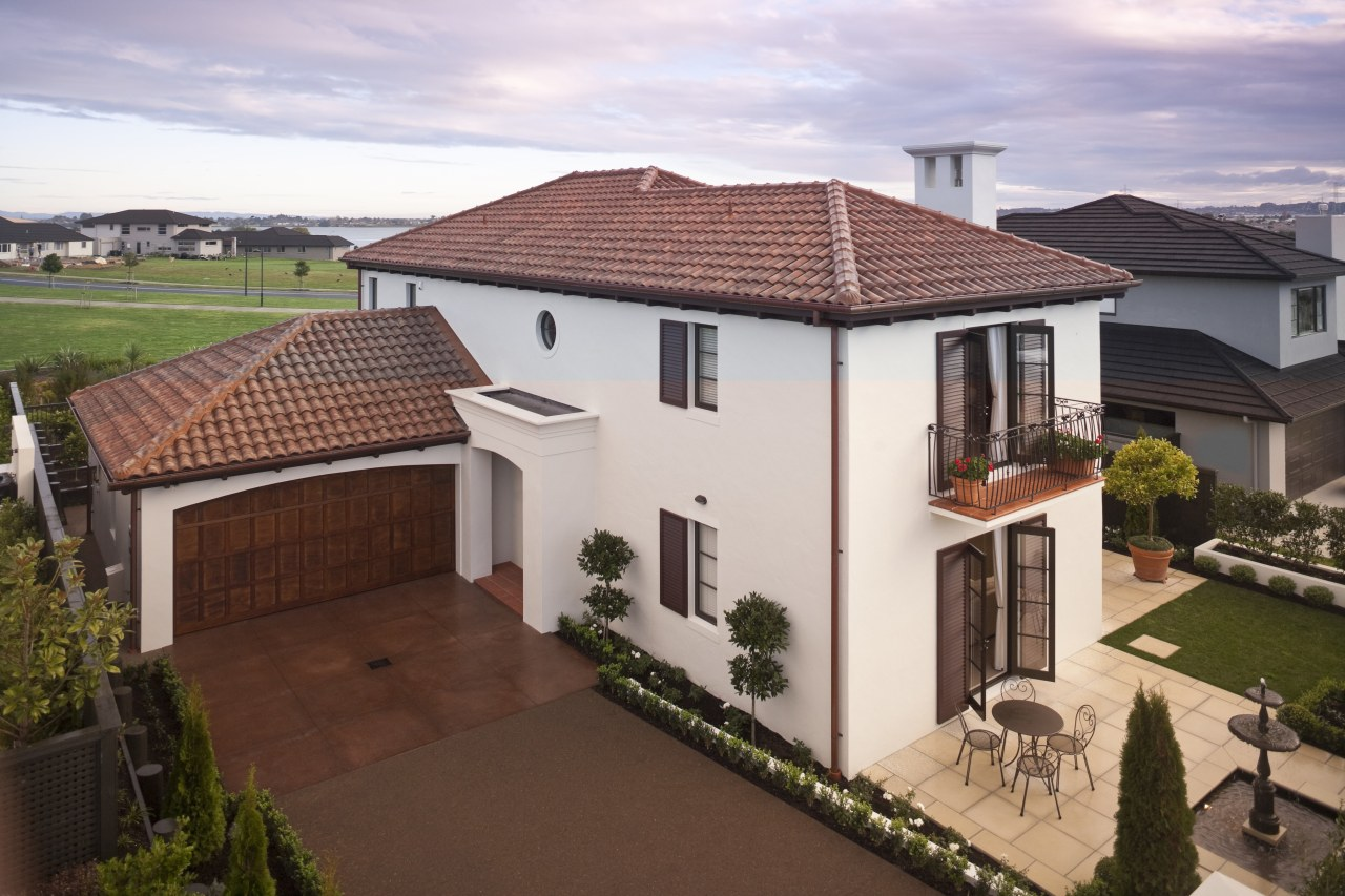 Exterior view of Eden Homes show home which building, elevation, estate, facade, home, house, mansion, outdoor structure, property, real estate, residential area, roof, suburb, villa