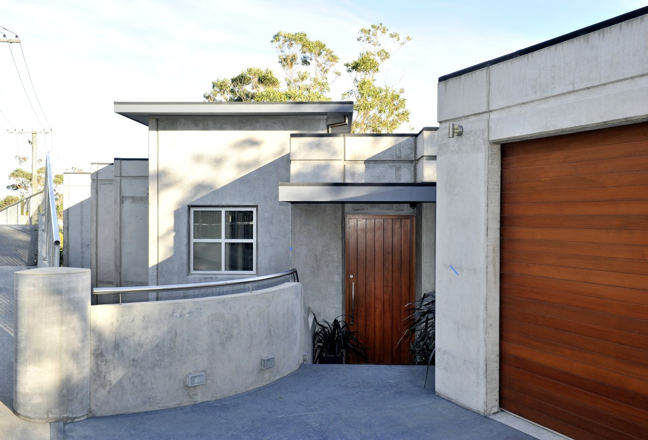 Exterior view of this contemporary home architecture, building, facade, home, house, property, real estate, roof, white, gray