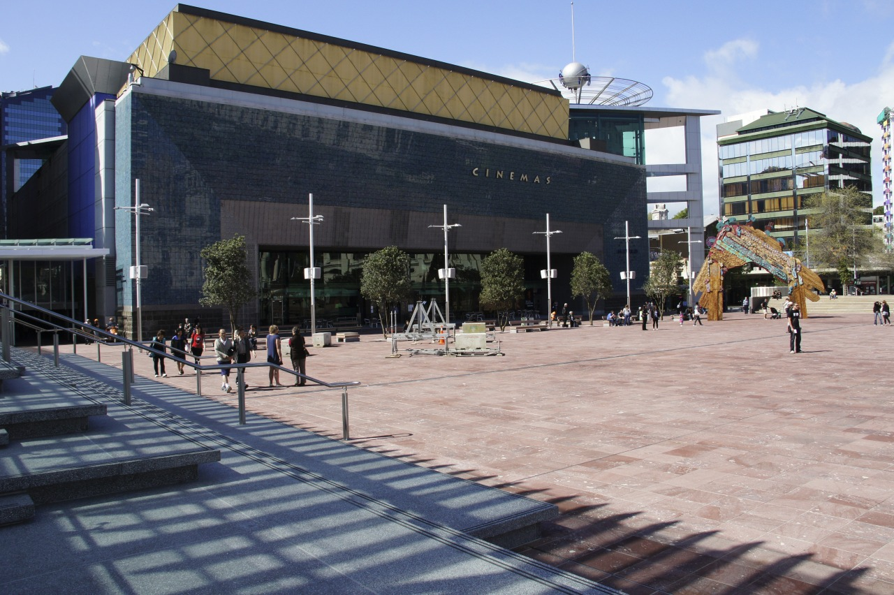 View of Aotea Square which features paving, planters, architecture, building, campus, city, downtown, metropolitan area, mixed use, neighbourhood, plaza, public space, structure, town square, urban design, black, gray