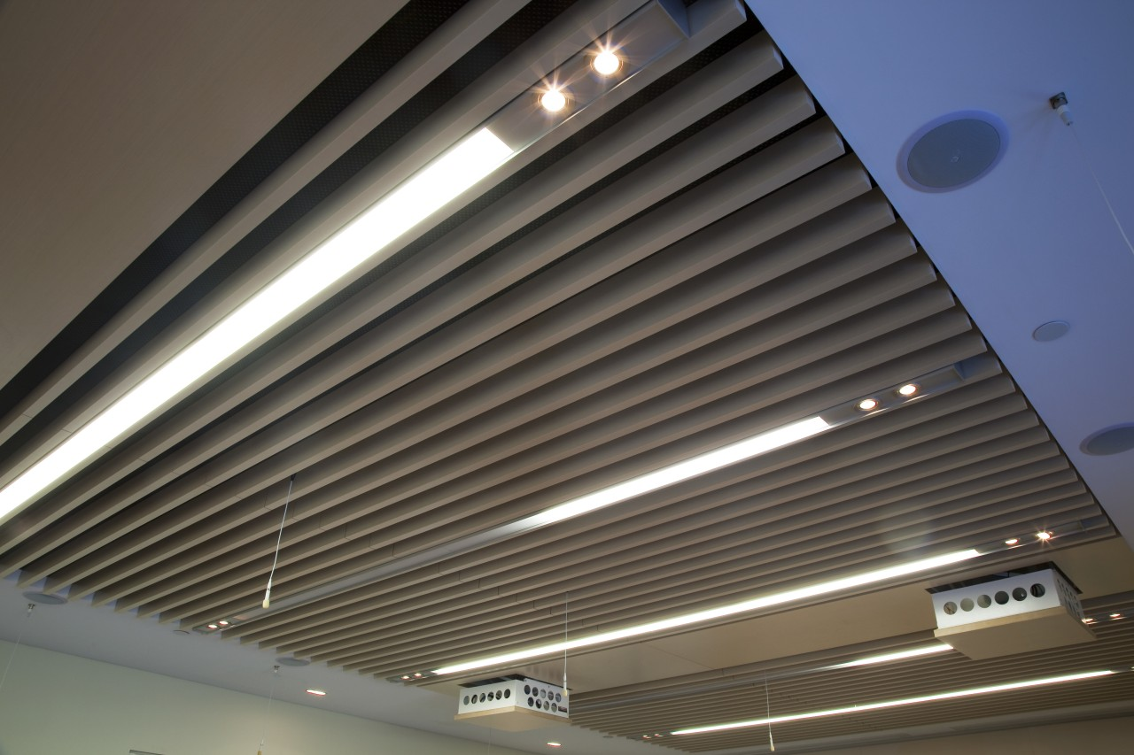 Interior view of the Poshe Centre which features architecture, ceiling, daylighting, daytime, light, lighting, line, roof, gray, black