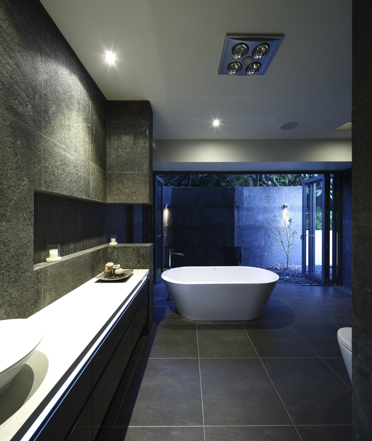 View of dark-toned bathroom with white tub. architecture, bathroom, ceiling, daylighting, estate, interior design, room, black, gray