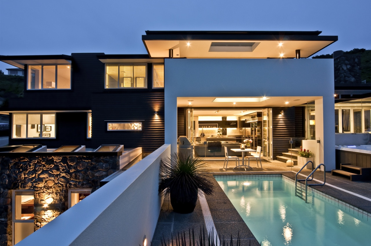 View of DJ Hewitt Builders home with plastered apartment, architecture, building, condominium, estate, home, hotel, house, property, real estate, resort, swimming pool, villa, teal