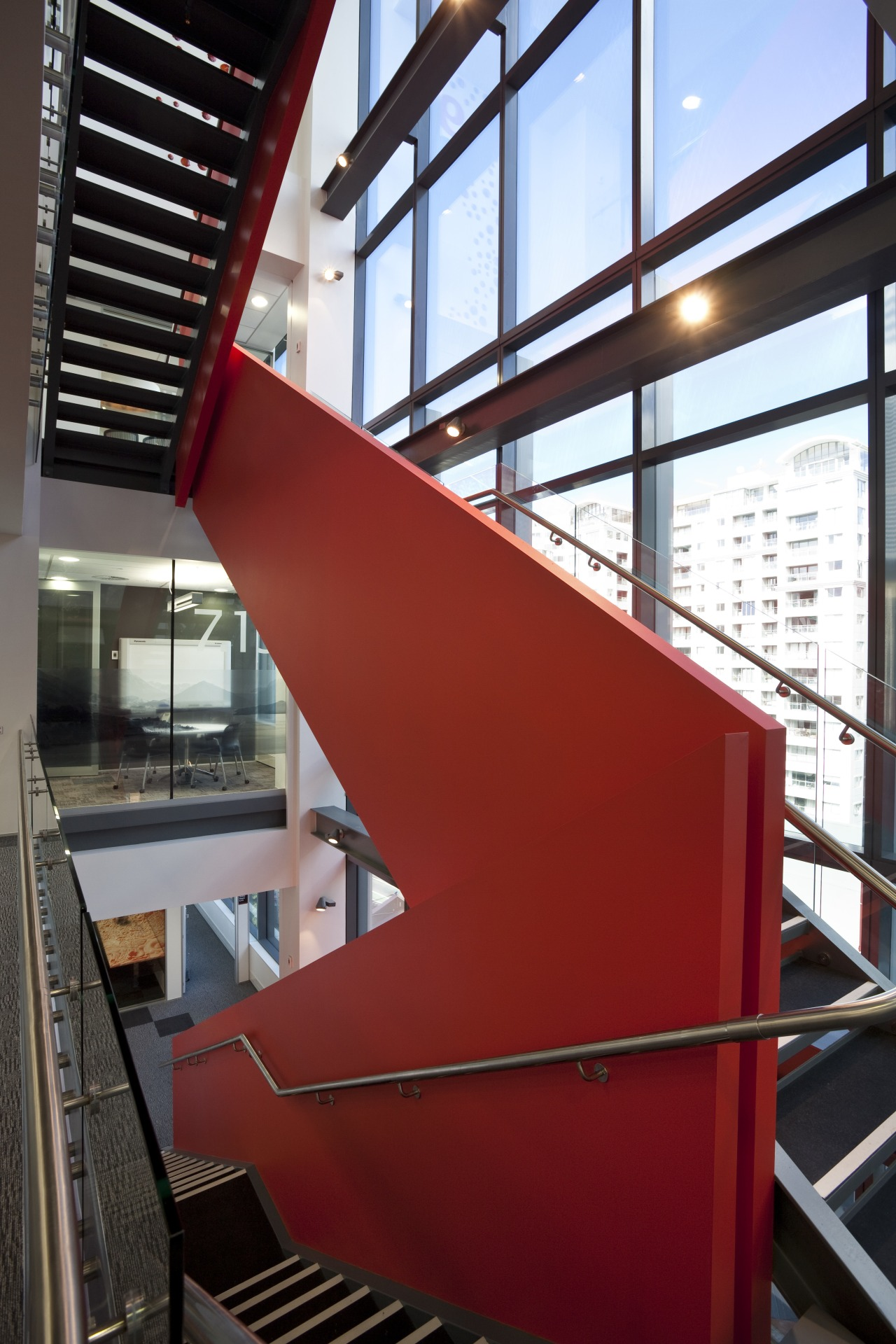 View of stairway with red wall at the architecture, building, daylighting, glass, handrail, line, stairs, structure, red