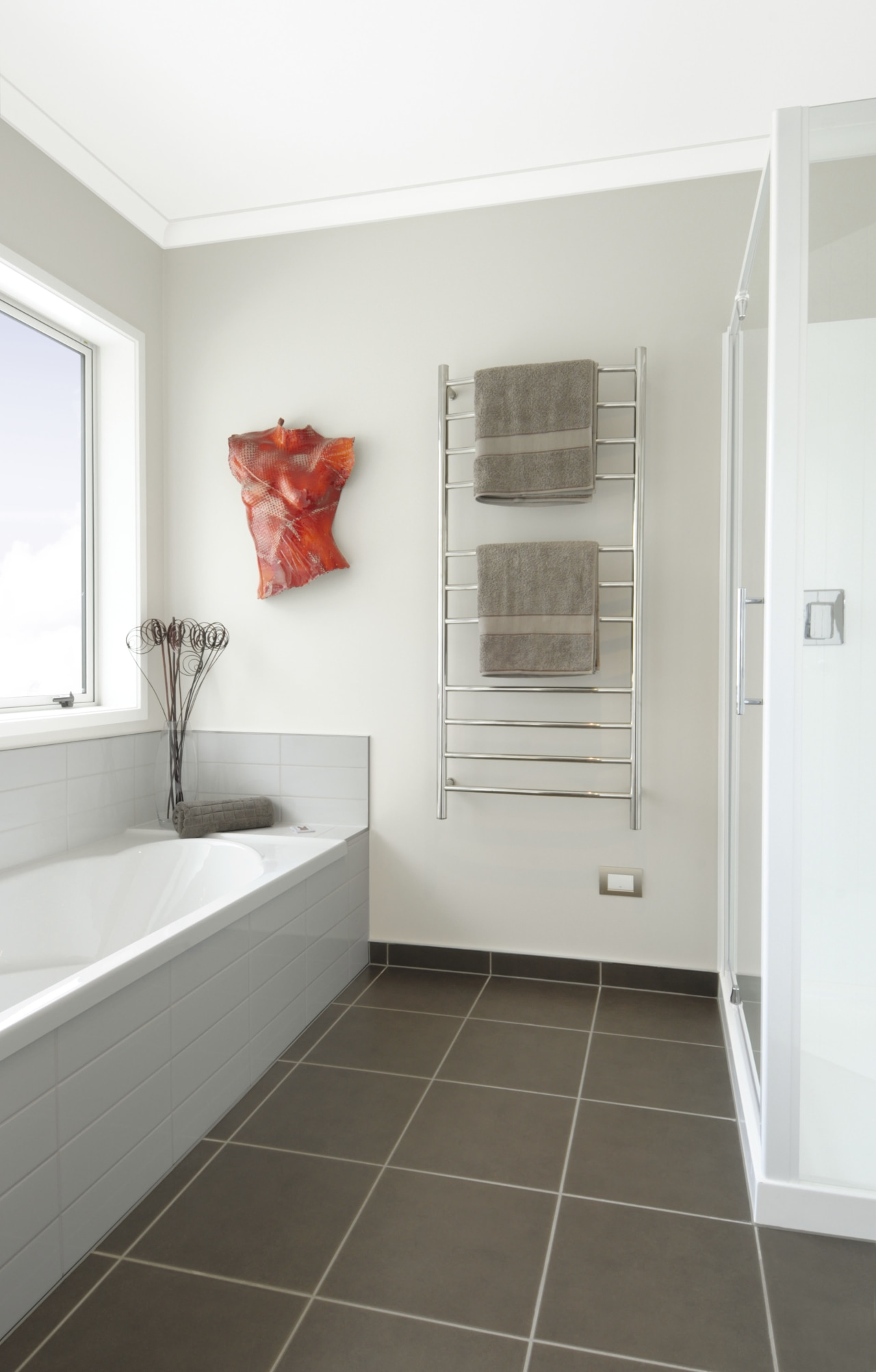 This show home was designed by Platinum Homes bathroom, floor, flooring, home, interior design, plumbing fixture, real estate, room, tile, white, gray