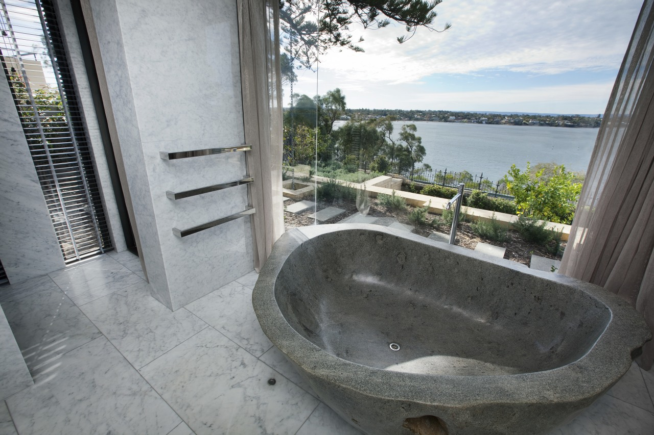 This master suite in a contemporary new house bathtub, estate, property, real estate, gray