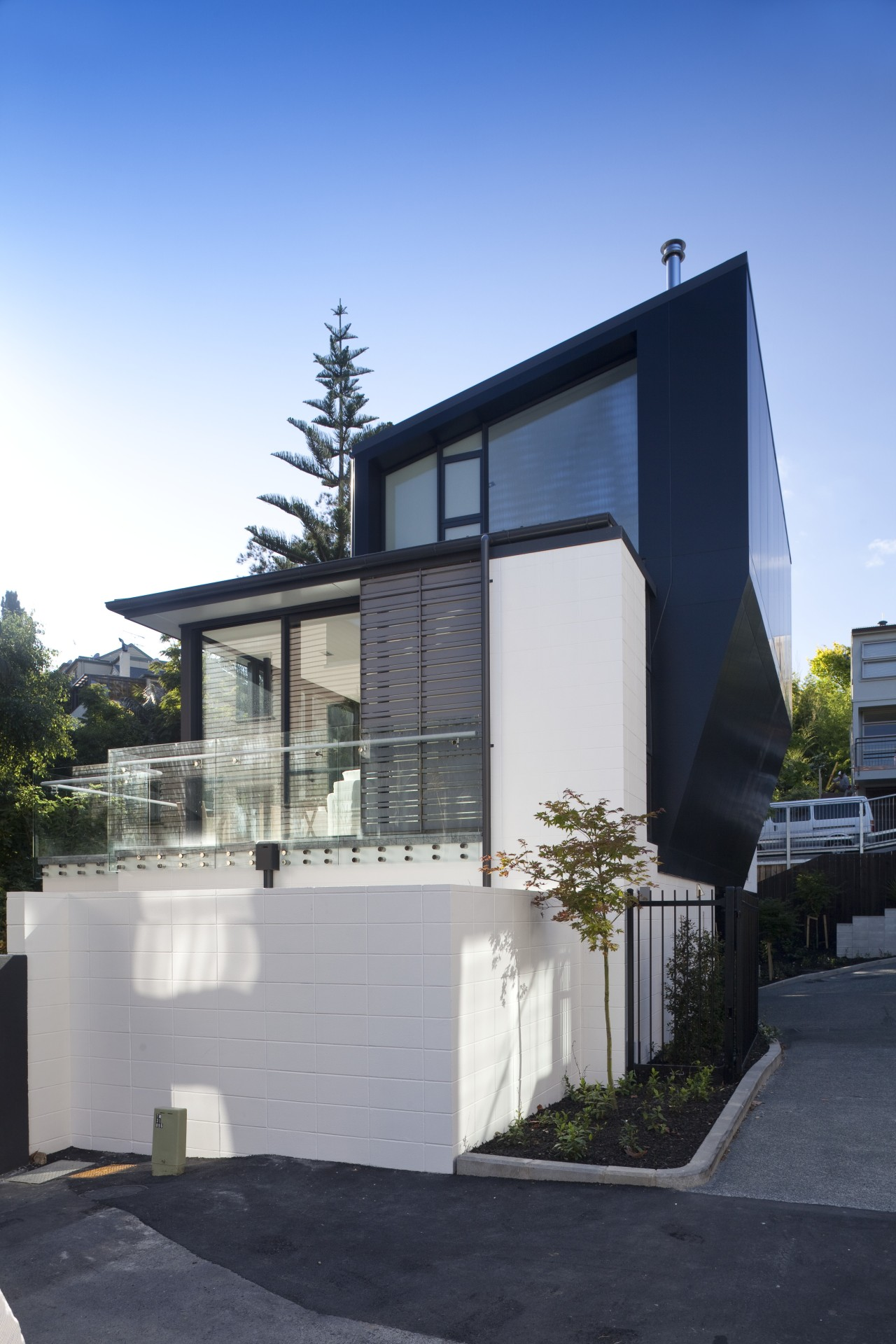 View of exterior with white and wall walls. architecture, building, elevation, facade, home, house, property, real estate, residential area