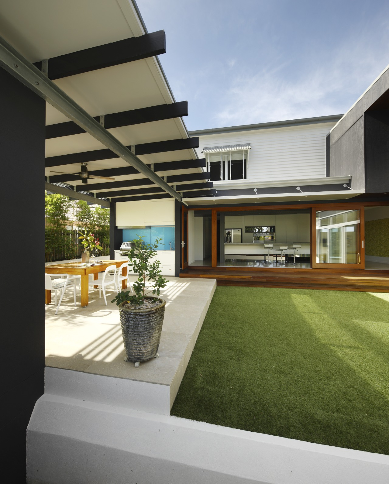 This modern extension houses two kitchens - one architecture, backyard, estate, facade, home, house, interior design, property, real estate, residential area, roof, window, yard, gray, brown