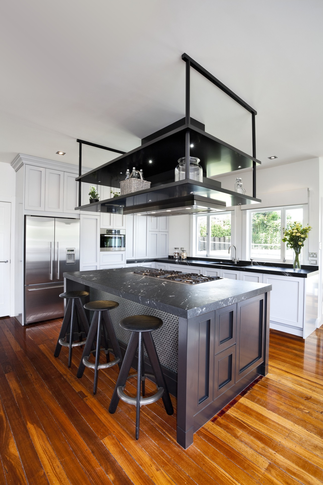 light stained wooden floors, dark island and white cabinetry, countertop, cuisine classique, floor, hardwood, interior design, kitchen, wood flooring, gray