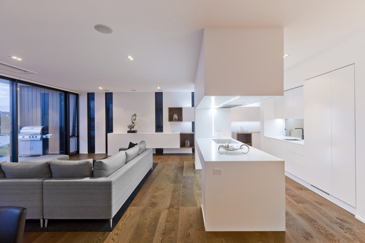 A view of a open plan kitchen and apartment, architecture, ceiling, floor, house, interior design, interior designer, living room, real estate, room, gray