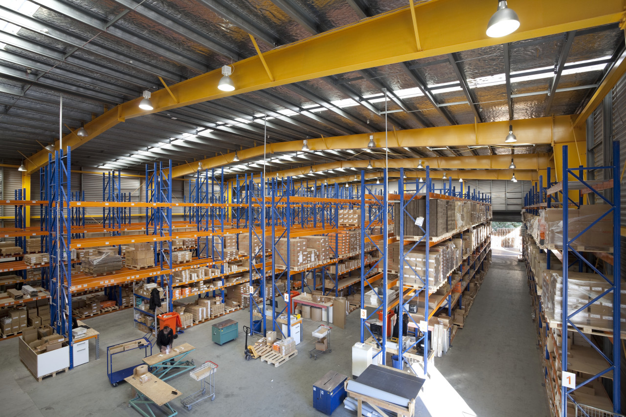 Interior of factory with yellow ceiling beams. factory, industry, inventory, manufacturing, warehouse