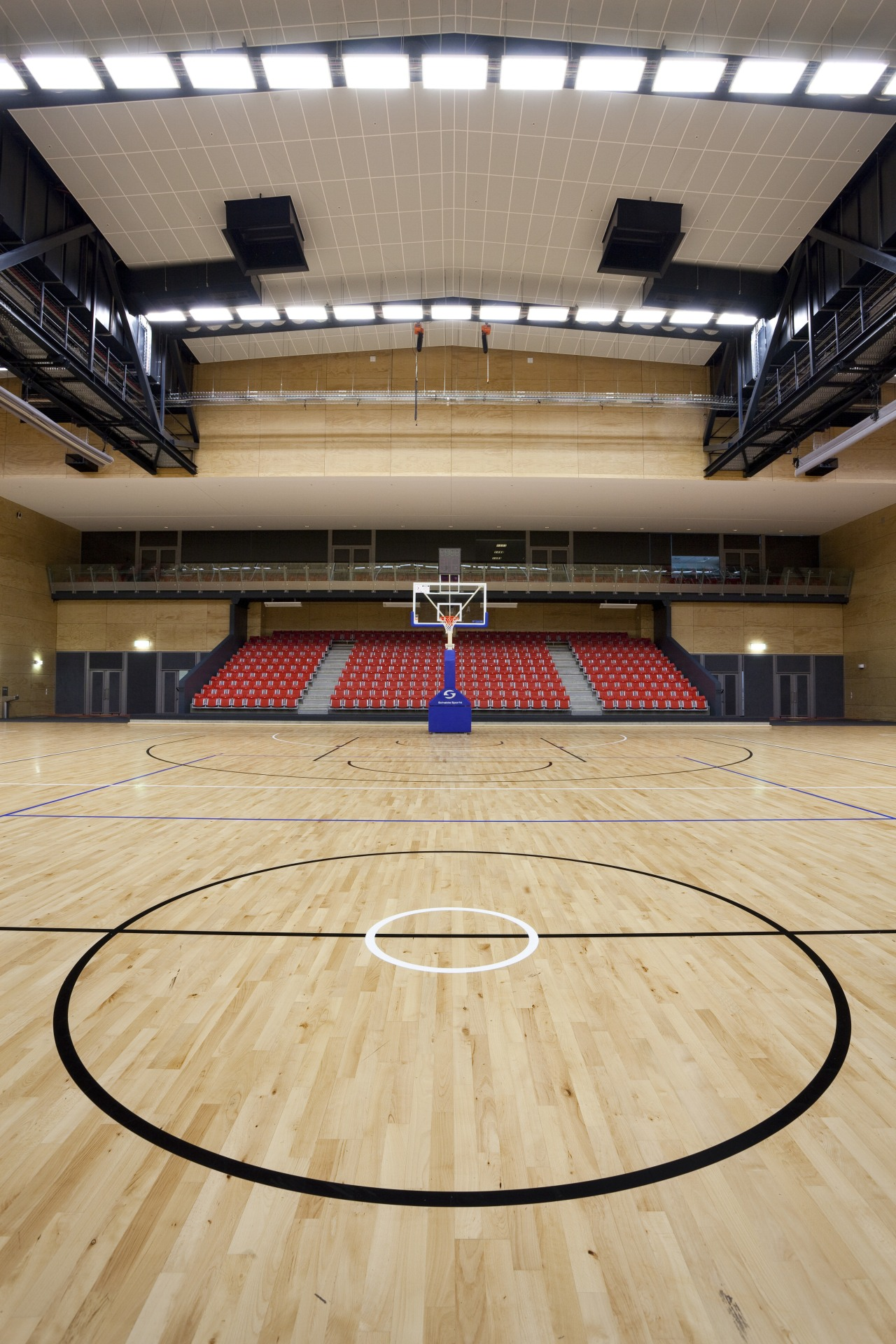 Indoor court with black lines. arena, basketball court, floor, flooring, hardwood, leisure centre, sport venue, sports, stadium, structure, wood, orange, gray