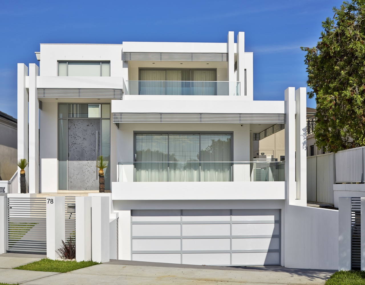 This home was designed and built by Starr architecture, building, door, elevation, facade, home, house, official residence, property, real estate, residential area, window, white, gray