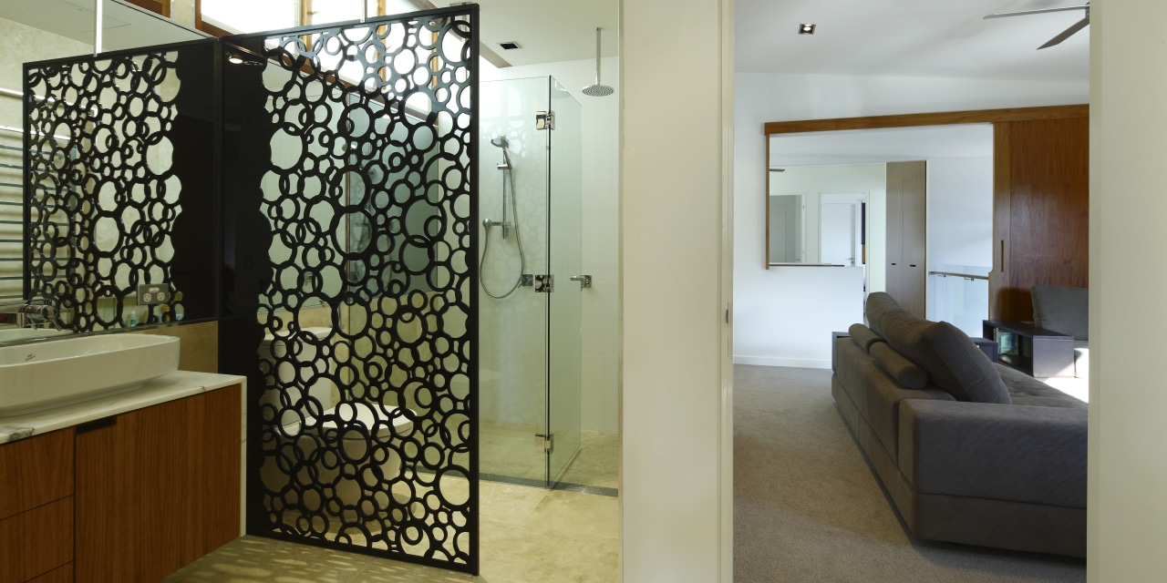 The glossy black acrylic privacy divider in this architecture, interior design, real estate, room, wall