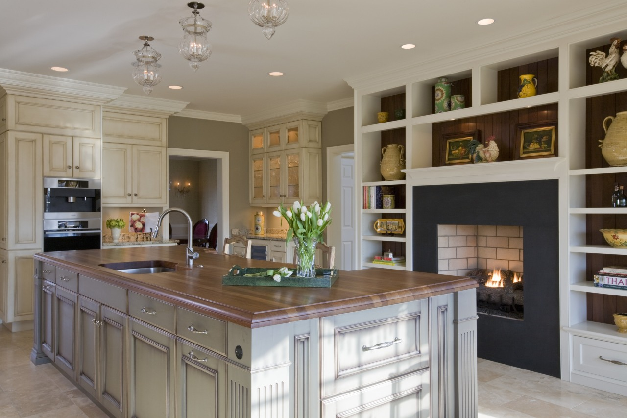 A large, multifunctional island is the centerpiece of cabinetry, countertop, cuisine classique, interior design, kitchen, room, gray, brown