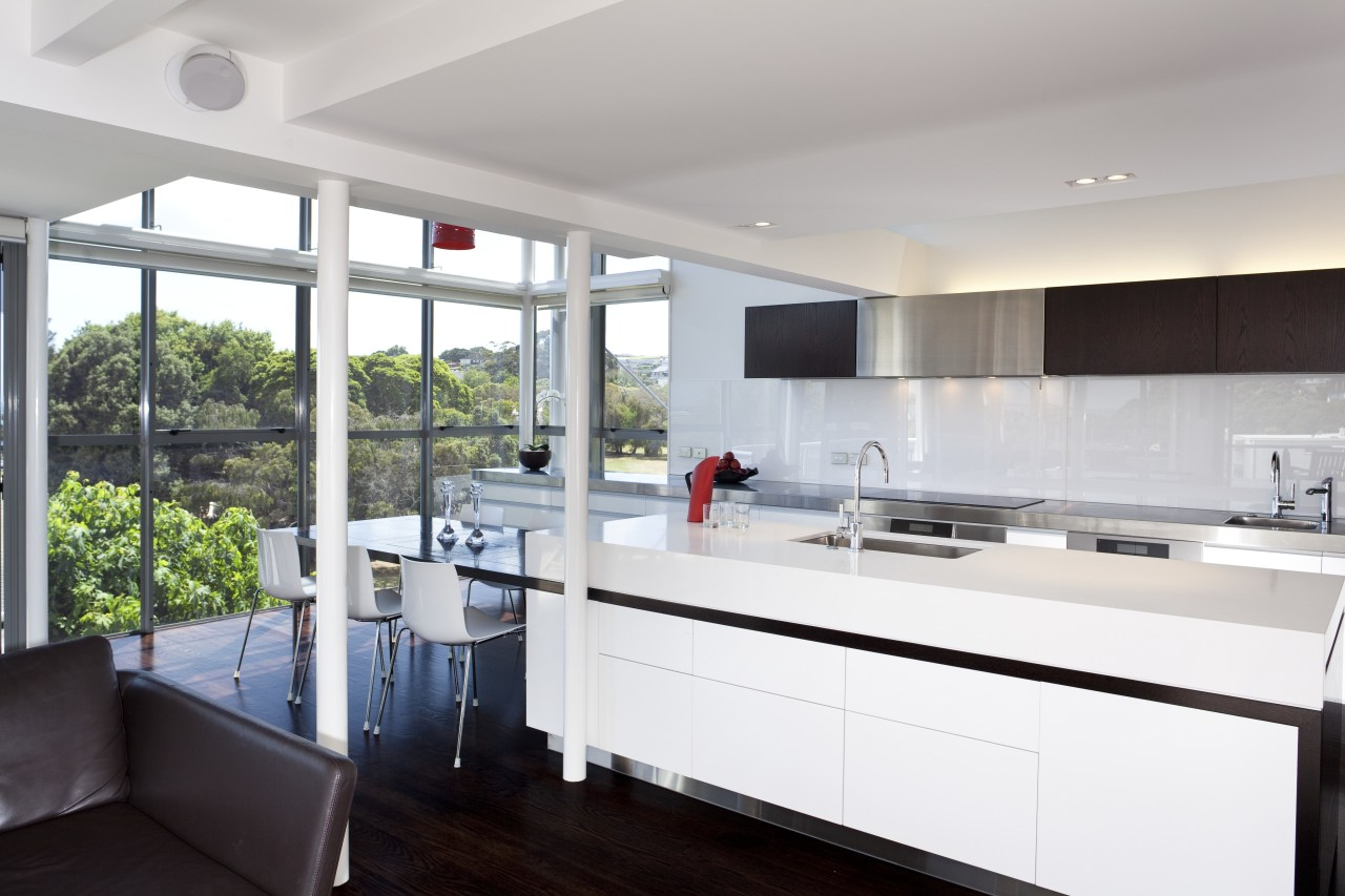 This light-filled kitchen is orientated to harness the countertop, interior design, kitchen, real estate, gray, white