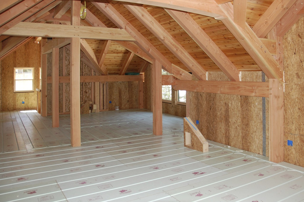 This home looks the part in a winter attic, beam, daylighting, floor, flooring, hardwood, home, house, log cabin, lumber, property, real estate, roof, room, structure, wall, wood, wood flooring, wood stain, orange, brown, gray